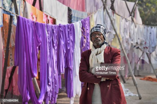 An elderly man wears warm clothes to protect himself from cold on a winter morning at Mahadev road on December 23 2018 in New Delhi India The...