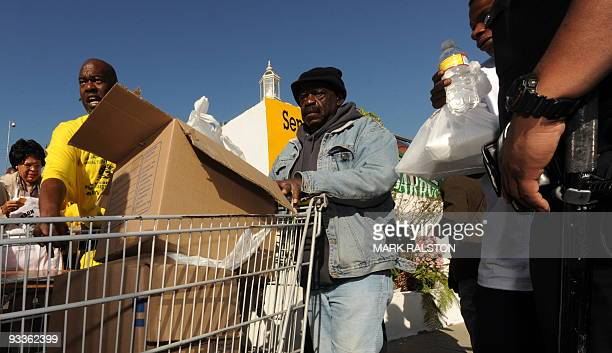 An elderly man who is one of a group of 10000 lowincome and needy people who lined up to receive free Thanksgiving turkeys and fixings distributed by...