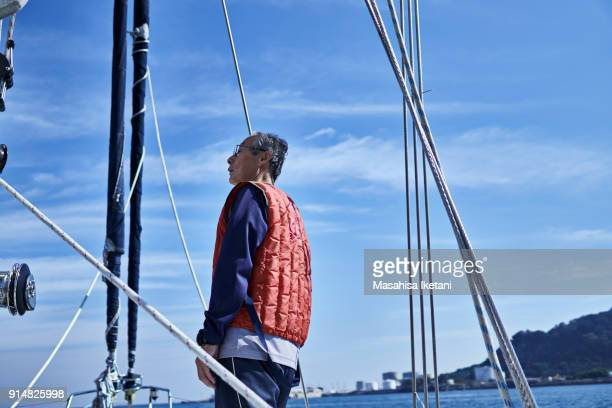 An elderly man who is ready to sail