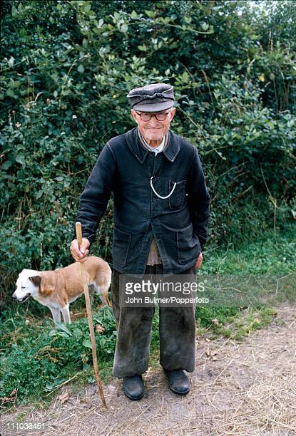 An elderly man with a dog in rural France circa 1970