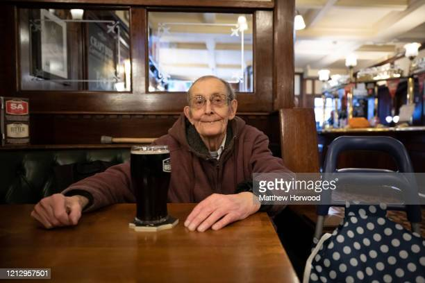 An elderly man with a pint of beer in the Goat Major pub in central Cardiff on March 17, 2020 in Cardiff, Wales. Boris Johnson held the first of his...