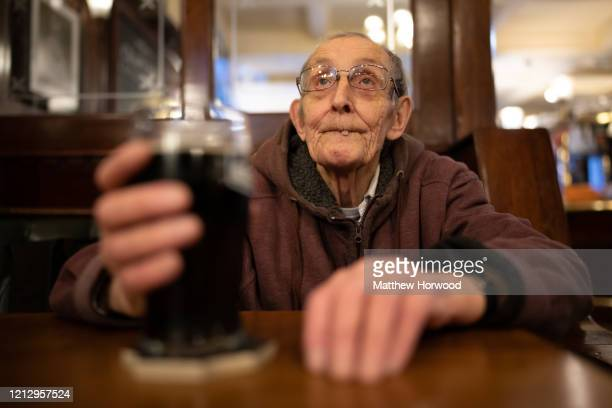 An elderly man with a pint of beer in the Goat Major pub in central Cardiff on March 17 2020 in Cardiff Wales Boris Johnson held the first of his...