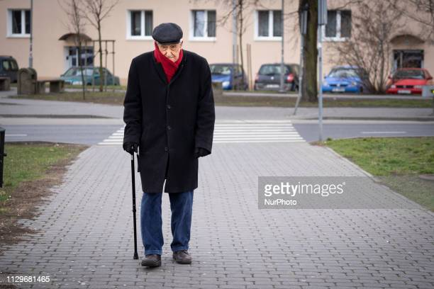 An elderly man with a walking stick is seen in the center of Bydgoszcz Poland on March 10 2019 In 2050 over half the population of Poland will be...