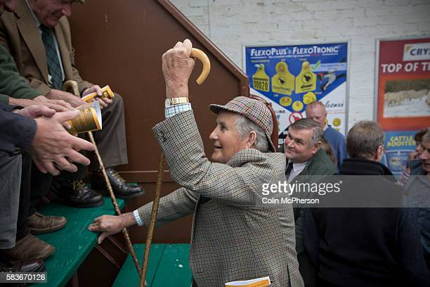 An elderly man with traditional tweed jacket deerstalker hat and a crook in conversation after the sheep competition at the Dalmally Agricultural...