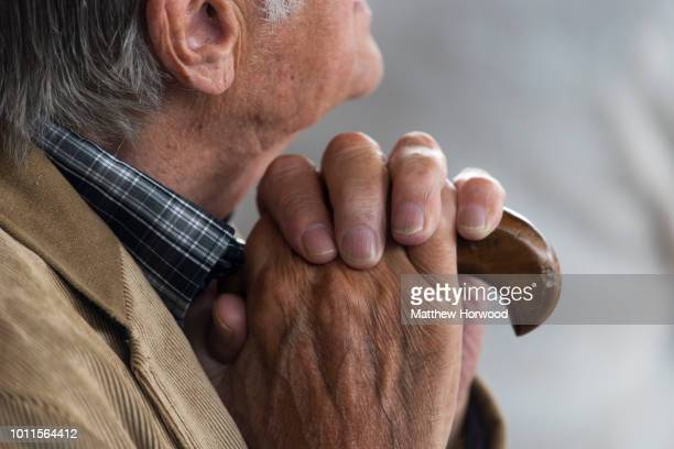 An elderly man's hands on a walking stick on June 6 2017 in Cardiff United Kingdom