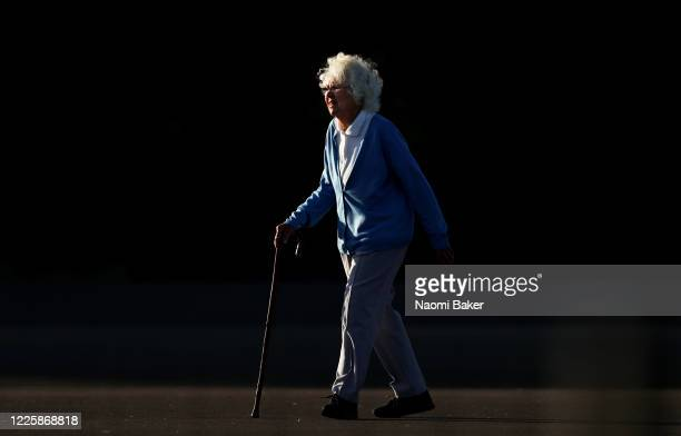An Elderly member of the public walks along the water front alone with a walking stick on May 19, 2020 in Lee-On-The-Solent, England. The British...
