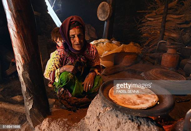 An elderly Moroccan woman makes bread in Taghzirt an isolated village in the elHaouz province in the High Atlas Mountains south of Marrakesh on March...