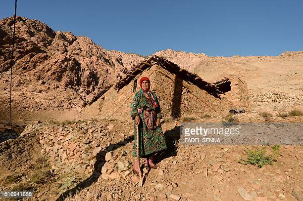 An elderly Moroccan woman walks in Zourhoune an isolated village in the elHaouz province in the High Atlas Mountains south of Marrakesh on March 4...