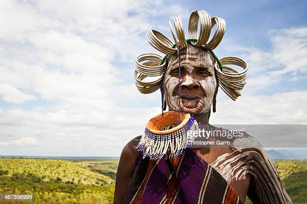 CONTENT] An elderly Mursi tribal woman poses for a portrait for tips in Mago National Park in the Omo Valley of Ethiopia The portrait highlights...