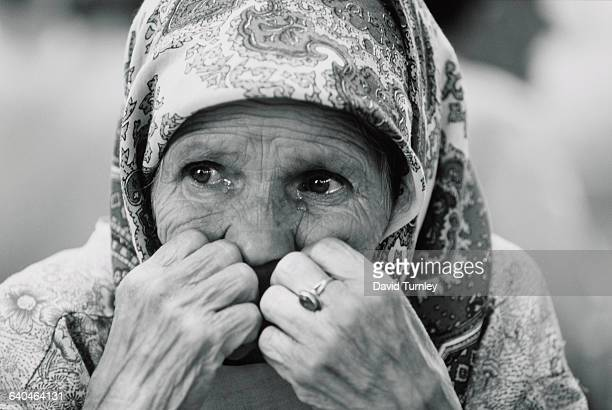 An elderly Muslim woman who had spent her entire life in the enclave of Srebenica sits confused and lost after being forced by Serb militia with the...