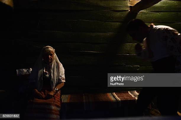 An elderly nestinar woman and man are preparing for the bare footed dance on the burning ashes in the Bulgarian village of Bulga on June 03 2015