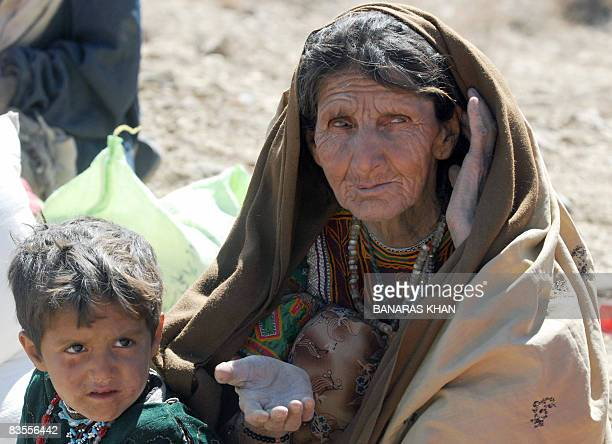 An elderly Pakistani earthquake survivor waits for relief supplies at a hilly area of Killy Kach one of about eight sparsely populated villages...