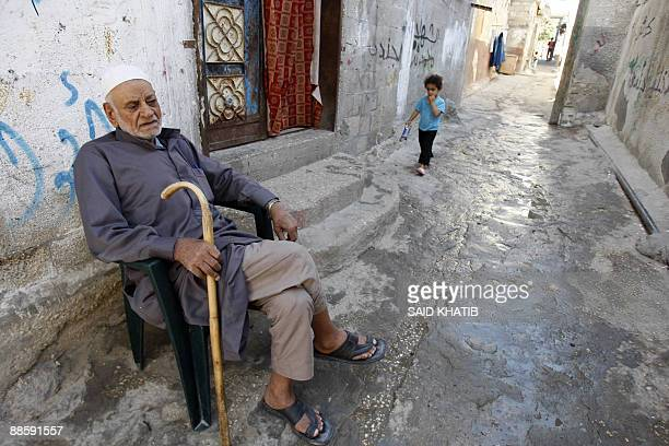 An elderly Palestinian sits outside his home in the southern Gaza Strip Rafah refugee camp, near the border with Egypt, on June 20, 2009....