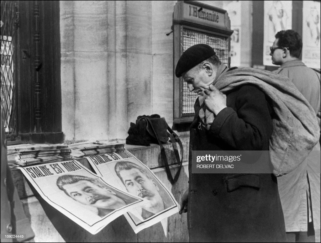 An elderly Parisian reads 06 March 1953 in Paris the communique announcing Soviet leader Stalin's death in the black-banded front page of the French communist party's official daily 'L'Humanité'. After a failed start as a novice priest, Stalin joined the ranks of the revolutionaries Bolsheviks who seized power in Russia in 1917. Rising ruthlessly through the political ranks of Soviet new regime, Stalin succeeded the Bolshevik leader Vladimir Lenin after his death in 1924 and installed a fearsome process of repression. He become later the head of the Soviet Union and died of a cerebral haemorrhage 05 March 1953.