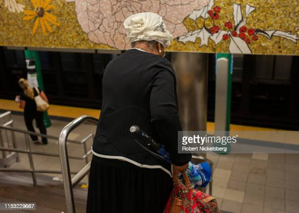 An elderly passenger walks to a subway platform in New York City on May 30, 2019. NYC Transit president Andy Byford has proposed a $40 billion Fast...