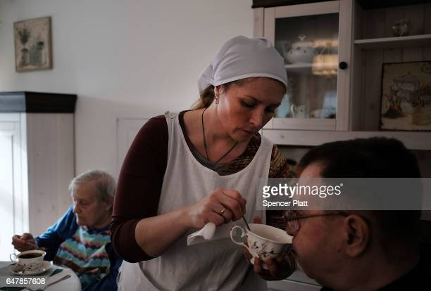 An elderly patient is fed by a nurse following Orthodox mass in a Moscow nursing home on March 4 2017 in Moscow Russia The home which houses nearly...