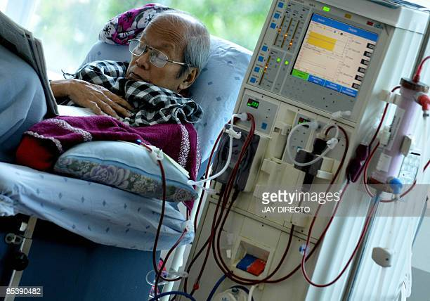 An elderly patient with failed kidneys undergoes dialysis at a government hospital in Manila on March 12 celebrated around the world as the annual...