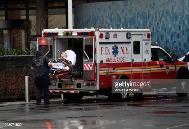 An elderly person with an undisclosed illness arrives on a stretcher and is admitted to NYU Langone Health Center hospital on March 23 2020 in New...