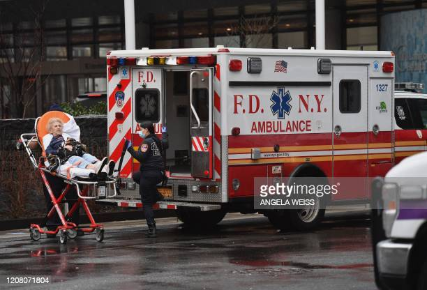 TOPSHOT An elderly person with an undisclosed illness arrives on a stretcher and is admitted to NYU Langone Health Center hospital on March 23 2020...