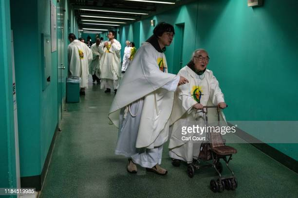 An elderly priest is assisted as he prepares to enter Tokyo Dome to attend Mass by Pope Francis on November 25, 2019 in Tokyo, Japan. Pope Francis...