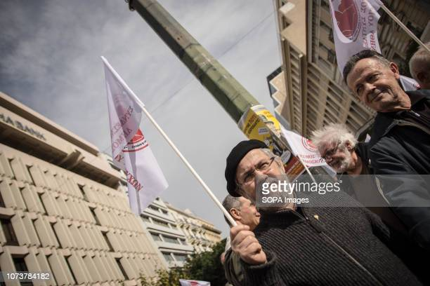 An elderly protester seen holding a flag during the protest A nationwide retirement protest took place in the center of Athens demanding for pensions