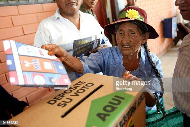 An elderly Quechua farmer casts her ballot in Bolivia's autonomy referendum and elections for the nation's upcoming constituent assembly in the...
