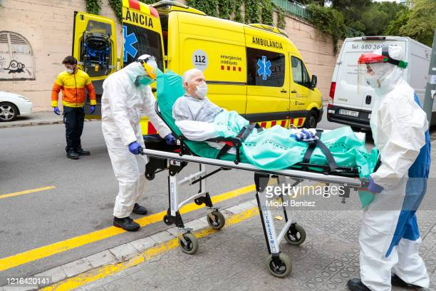 An elderly resident from the Fundacio Casa Asil Sant Andreu de Palomar care home who is showing symptoms of coronavirus is transported by ambulance...