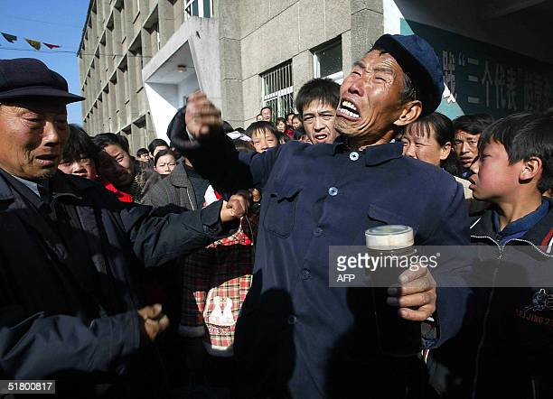 An elderly retired miner screams in anger against the management of the Chenjiashan coal mine in Tongchuan city north China's Shaanxi province 29...
