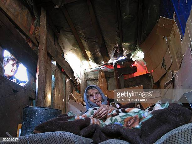 An elderly Roma woman covered in old blankets lies in a shack builtup with carton boxes in the suburbs of FusheKruje some 30 Kilometers from Tirana...