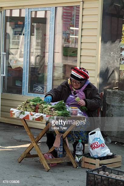 An elderly Russian woman selling vegetables beside the railway station in Tomsk. Despite Russia's tremendous economic growth in recent years, one in...