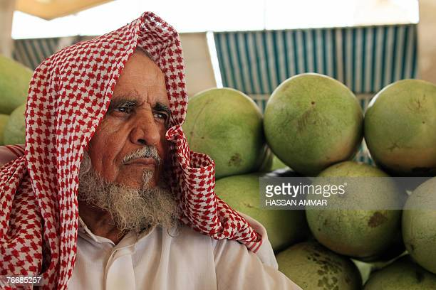 An elderly Saudi man sells watermelon at Otaiga market in Riyadh 12 September 2007 a day before the start of the holy Muslim fasting month of Ramadan...