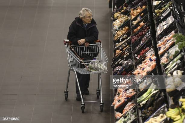An elderly shopper browses fresh fruit and vegetables inside a J Sainsbury Plc supermarket in Redhill UK on Tuesday March 27 2018 Mike Coupe J...