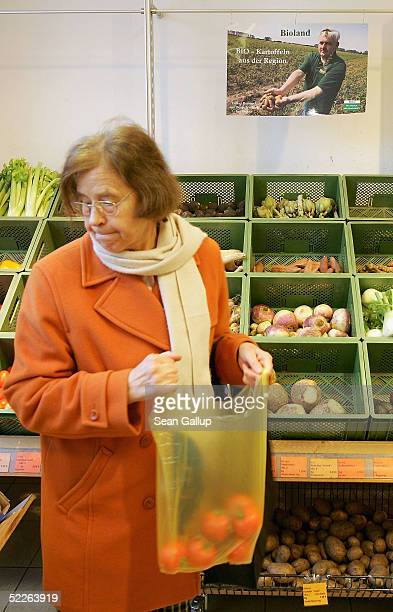 An elderly shopper buys vegetables at a store of German organic supermarket chain EO Komma March 2 2005 in Berlin Germany According to the...
