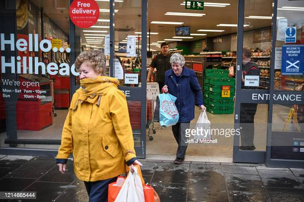 An elderly shopper leaves an Iceland shop on Byres Road to allow older shoppers to buy food when it is quieter amid the coronavirus outbreak on March...