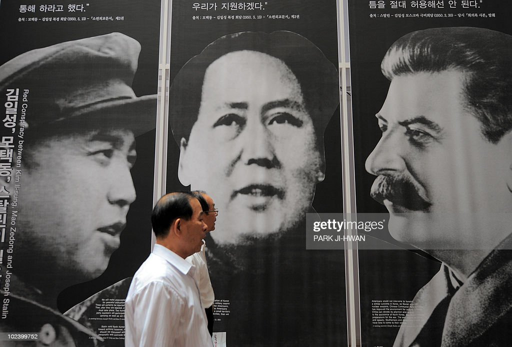 An elderly south korean visitor passes b pictures getty images an elderly south korean visitor passes by the portraits of north koreas late president kim il thecheapjerseys Choice Image