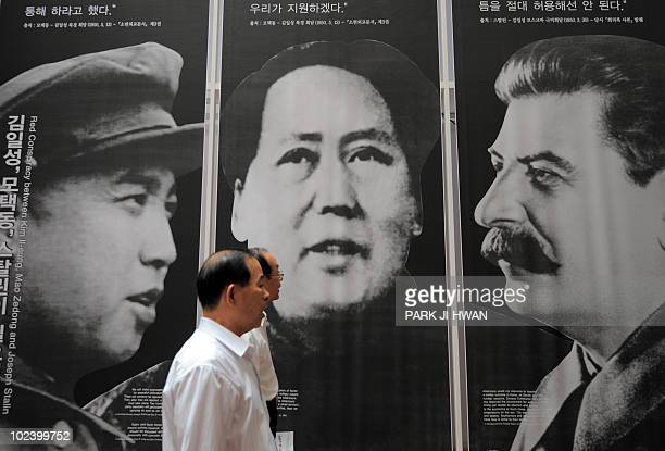 An elderly South Korean visitor passes by the portraits of North Korea's late president Kim IlSung former Chinese leader Mao Zedong and former Soviet...