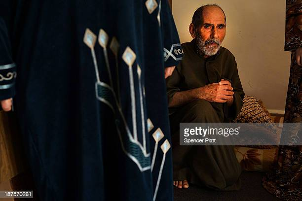 An elderly Syrian man rests in the apartment he shares with other Syrian refugees in a poor section of Beirut where the majority of residents are...
