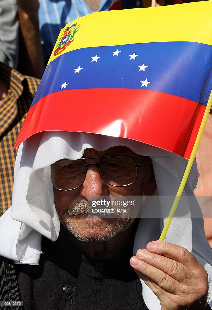 An elderly Syrian man waves Venezuela's flag during a visit by President Hugo Chavez to Sweida, 100 kms south of Damascus, on Septamber 4, 2009. Chavez visited Sweida, homeland of many of Venezuela's million strong Syrian community, a day after holding talks with Syrian President Bashar al-Assad.