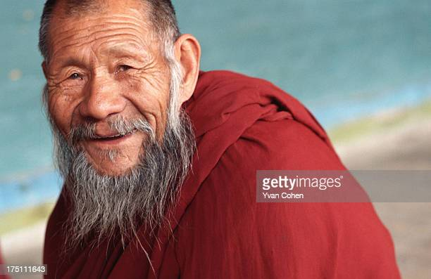 An elderly Tibetan monk smiles at the camera at Kumbum monastery Kumbum was the birth place of the Tsongkhapa Lama who founded the Gelugpa sect of...