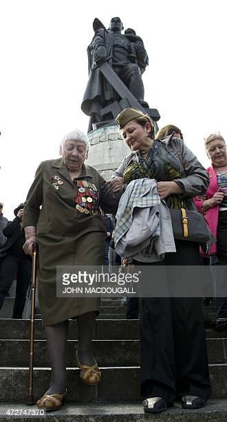 An elderly veteran climbs down the stairs after laying flowers at the Soviet soldier monument of the Soviet War Memorial in Berlin's Treptow district...