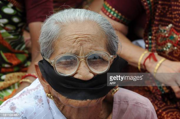 An elderly Vishwa Hindu Parishad supporter particpates along with her colleagues in a Mourn Rally in Ahmedabad on September 1 2012 Vishwa Hindu...