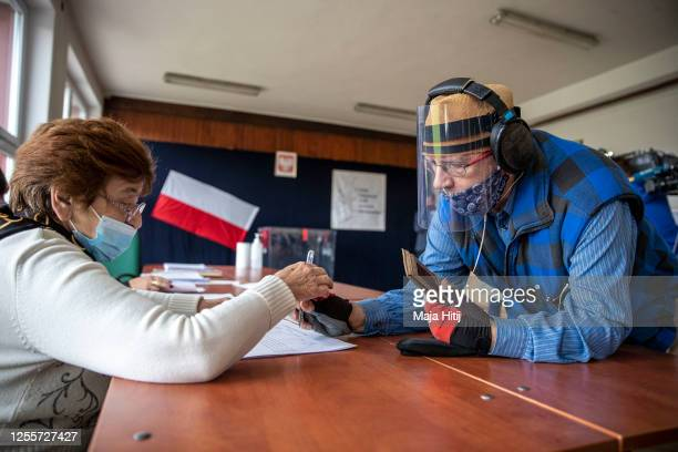 An elderly voter arrives to cast his ballot during Poland's Presidential elections runoff on July 12, 2020 in Krakow, Poland. The latest polls...