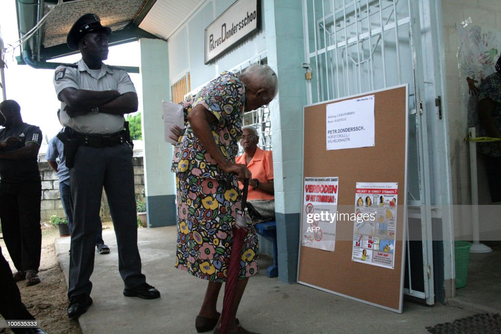 An elderly woman arrives at a polling station May 25, 2010 early morning, in Paramaribo. AFP PHOTO/Louis ALFAISIE