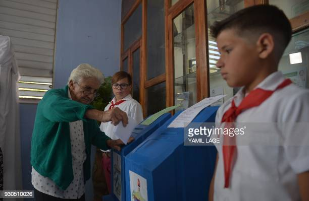 An elderly woman casts her vote at a polling station in Santa Clara Cuba during an election to ratify a new National Assembly on March 11 2018 Cubans...