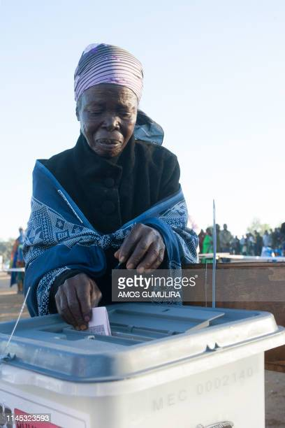 An elderly woman casts her vote at Goliati Primary School in Goliati village the home of Malawi's President Arthur Peter Mutharika in Thyolo District...