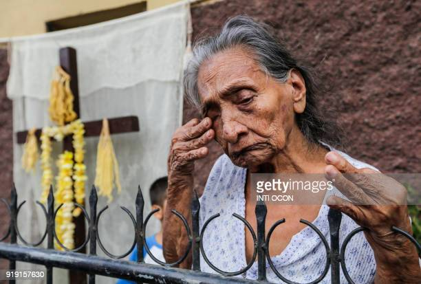 An elderly woman cries after parishioners carrying a statue of Jesus Christ pass by during the first Via Crucis of Lent in Granada about 45 km from...