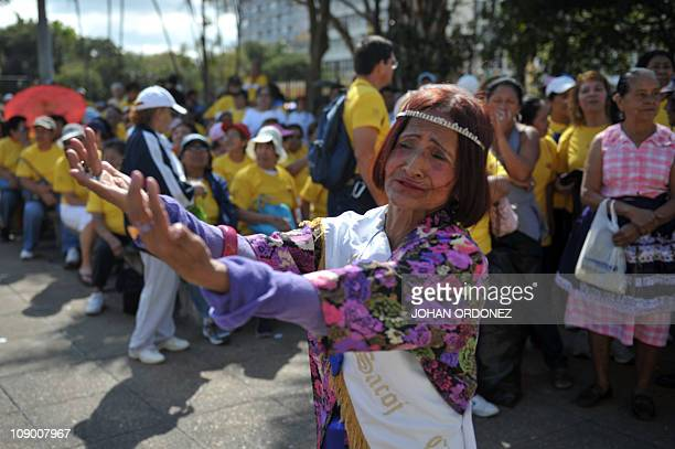 An elderly woman dances during the Old Love Parade held as part of the celebrations of Saint Valentine's Day on February 11 2011 at Constitution...