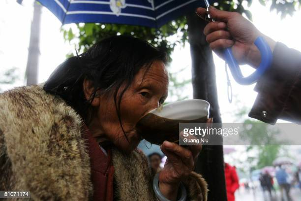 An elderly woman eats food May 13 2008 in Sichuan province Dujiangyan City China A major earthquake measuring 78 on the Richter scale jolted Wenchuan...