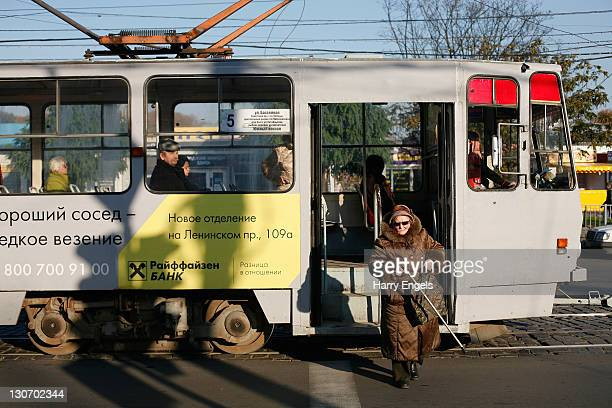An elderly woman gets off a tram on October 28 2011 in Kaliningrad Russia Kaliningrad is one of thirteen proposed host cities and 2018 will be the...