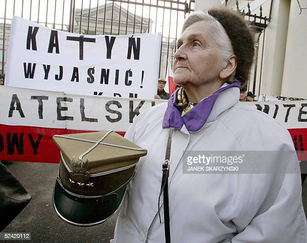 An elderly woman holds a busby of a Polish former officer as she takes part in a demonstration in front of the Russian embassy in downtown Warsaw 15...